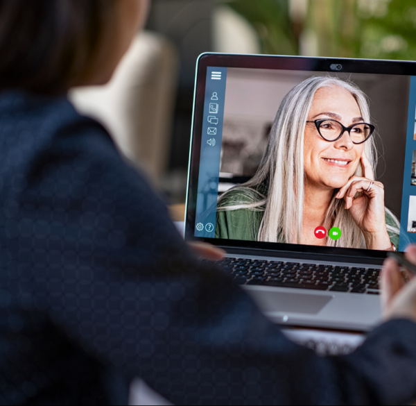 laptop showing two people on a video call